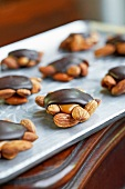 Home-made chocolate caramel turtles with almonds