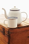 Rustic Enamel Coffee Pot and Cup on Wooden Crate