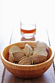 Wooden Bowl of Empty Clam Shells; Nearly Empty Glass of Beer