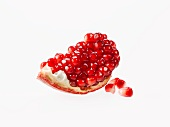 Piece of Pomegranate with Seeds; White Background