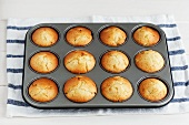 Peach muffin in a muffin tin
