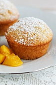 A peach muffin with peach compote