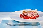 Strawberry mousse in puff pastry on balsamic strawberries