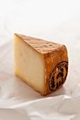 Pecorino (a slice of Pecorino on a piece of wax paper)