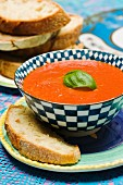 Tomato soup with basil in a soup bowl