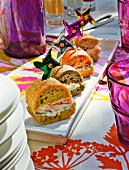 Exotic sandwiches with mini pinwheels at a summer buffet in the garden