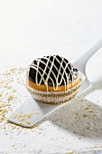 A Hanukkah doughnut topped with chocolate glaze