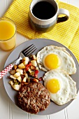 Buffalo Breakfast Sausage with Sunny Side Up Eggs; Coffee and Orange Juice