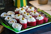 Beetroot puree with cream cheese topping and green olives
