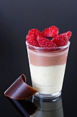 Layered dessert made with vanilla cream, chocolate mousse and fresh strawberries