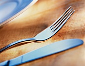 Cutlery on a wooden surface
