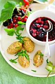 Redcurrant compote with sour cream dumplings
