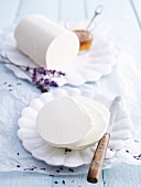 A roll of cream cheese with lavender flowers