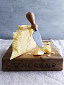 Parmigiano (a piece of Parmesan cheese on a chopping board)