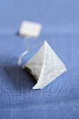 A pyramid-shaped tea bag