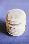 A stack of round tea bags