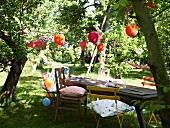 Table & chairs in garden for child's birthday party