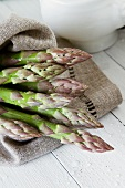 Green asparagus on a linen cloth