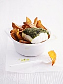 Cod with a herb crust and potato wedges