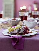 Marinated pot roast with raisin sauce, dumplings and red cabbage