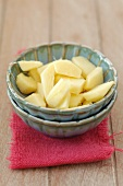 Pieces of fresh ginger in a bowl