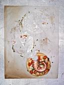 Pizza mit Oktopus, angebissen