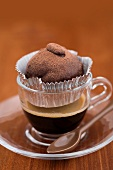 A cake ball in an espresso cup