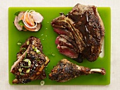 Assorted Barbecued Meat on a Green Cutting Board
