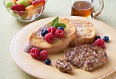 Chicken Sausage Patty and French Toast with Fresh Berries; Syrup and Fruit Salad