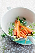 Carrots in a sieve