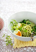 Spaghetti with pea pesto and eggs