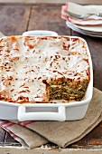 Spinach Lasagna in Baking Dish with a Serving Removed