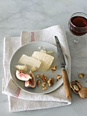 Parmesan Cheese, Figs and Walnuts on a Plate