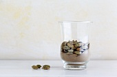 Whole and ground cardamom in a glass