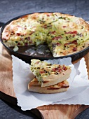 Quiche with potatoes, bacon and leek