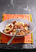 Sauerkraut salad with smoked pork and pears
