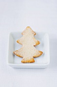 A Christmas tree-shaped butter biscuit