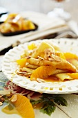 Crepes Suzette with oranges and slivered almonds