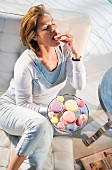 Woman relaxing, eating cookie