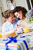 Couple on birthday breakfast table
