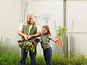 Farmer And Daughter With Vegetables