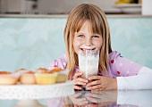 Girl with chocolate milkshake and cream