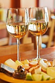 Two Glasses of White Wine with Fruit and Cheese