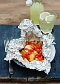 Patatas bravas (tangy chunks of potato in spicy tomato sauce, Spain)