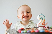 baby laughing with birthday cake