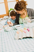 mother and child coloring Easter eggs
