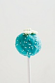 Blue Cake Pop with white sugar pearls and flowers
