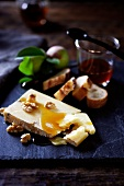 Cheese with Honey and Walnuts; Slices of Bread