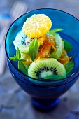 Fresh Kiwi, Orange and Mint Salad in a Blue Glass
