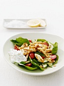Spinach salad with octopus, tomatoes and cucumbers